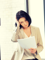 calm woman with documents