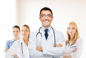 smiling male doctor in white coat at hospital