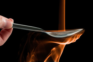 Smoke made to look like fire pouring on a spoon.