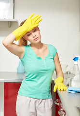 tired woman cleaning home kitchen