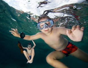 Happy boys  snorkeling in a sea