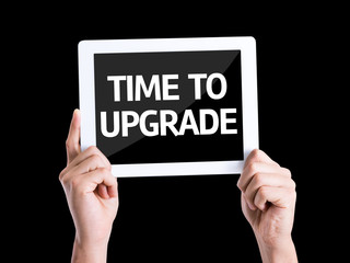 Tablet pc with text Time To Upgrade isolated on black