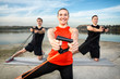 Sporty people with stretching band