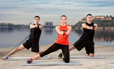 Three young people exercising