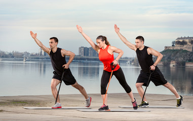 Group  doing exercise with resistance rubber
