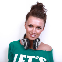 girl in green jacket poses  in  DJ's earphones