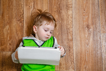 Portrait of a little boy with a tablet pc