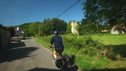 Man cycling on road in countryside