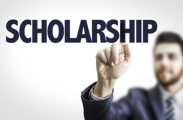 Business man pointing the text: Scholarship