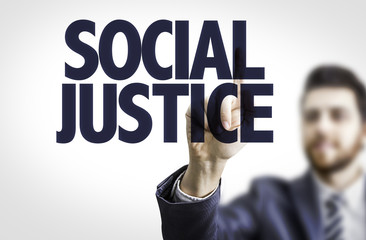 Business man pointing the text: Social Justice
