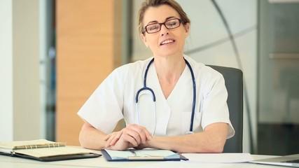 Nurse working in hospital office