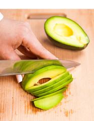 slicing fresh avocado close-up