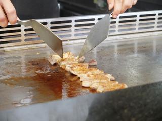 Chef Preparing and Cooking Traditional Pork teppanyaki