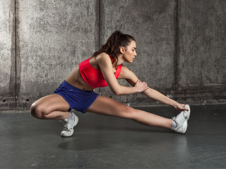 Fit woman stretching her leg to warm up