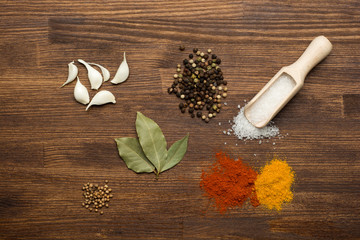 Colorful spices on rustic wooden table
