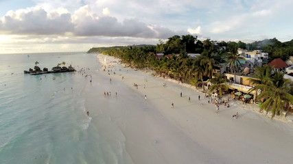Aerial flight above white beach and Willy's Rock at Boracay Bea