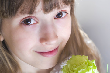 Smiling girl holding a beautiful white rose