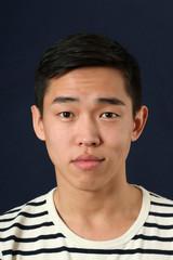 Romantic young Asian man looking at camera