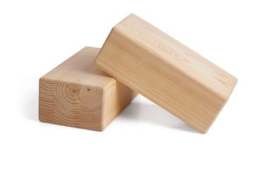 Wooden bricks for yoga on a white background