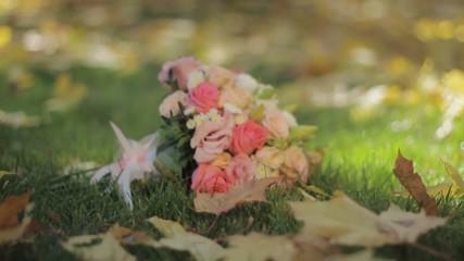 Wedding bouquet on the grass in autumn