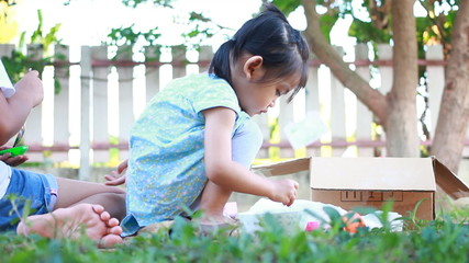Asian baby with sister have fun to play ground