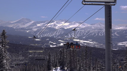 Ski Chairlift with Slopes in Background