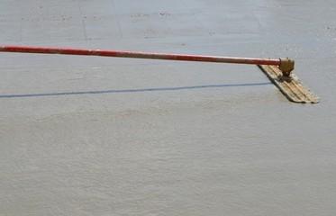 Floating a concrete slab
