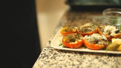 Putting parmesan on vegetable meal before serving
