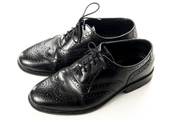 black leather man shoes on white isolated