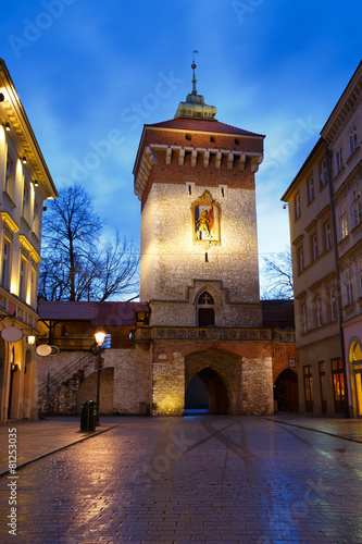 City wall and gate in the old town of Krakow, Poland.