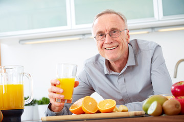 Senior man with a glass of orange juice