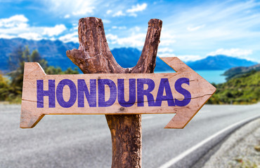 Honduras wooden sign with road background