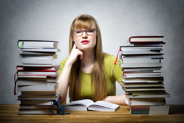 Female Student with many books