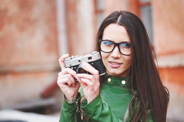 Portrait of a beautiful adult sensual woman with retro camera.