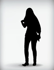 Black silhouette of a woman isolated on a white background