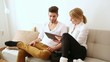 Young couple with a Tablet PC on the Sofa