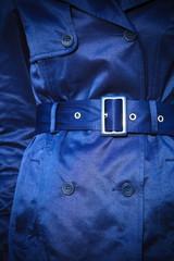 Female fashion. Closeup blue coat wit belt
