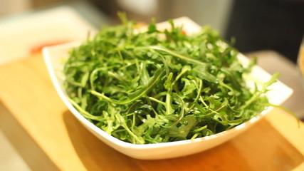 Fresh rocket salad in bowl