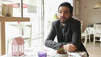 Handsome young man talking in a restaurant