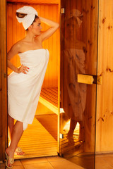 Woman white towel in sauna room