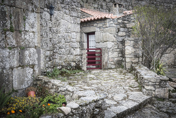 rustic house made of stones and a wall