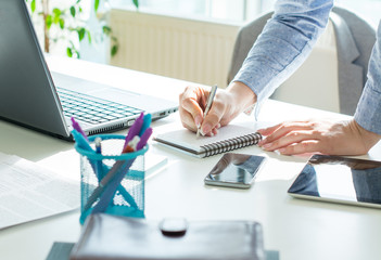 Successful interior designer woman working at office