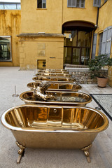 Brass Bathtubs and Statue