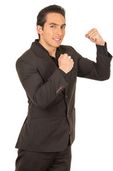 handsome young man wearing a suit posing with fists up gesturing