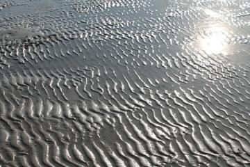 Sonnen Spiegelung im Watt bei Ebbe