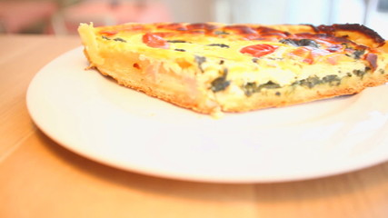 Vegetable quiche served on a plate in a restaurant