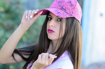 Sweet young lady with pink hat