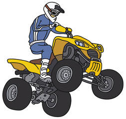 Rider on the yellow all terrain vehicle