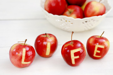 Red apples with the words Life engraved on them