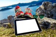 Digital tablet with shoes and glasses on the mountain - 81262676